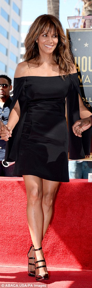 Two paws up: The Catwoman actress looked stunning in this mini dress