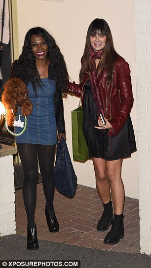 X Factor regular: Simon's ever-present pal Sinitta also emerged clutching her cute pet pooch while wearing a denim minidress and opaque black tights