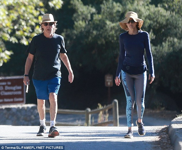 I feel fine: The Beatles legend looked fit in Nike trainers, blue shorts and a dark grey tee, topping the outfit off in a straw fedora