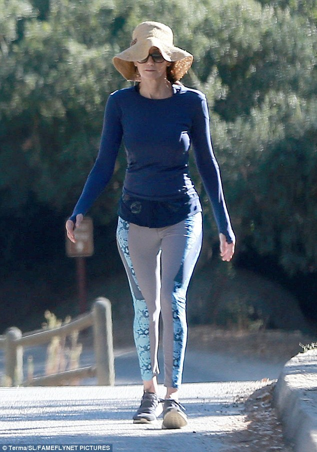 She loves you:His 56-year-old wife meanwhile showed off her fab figure in a pair of tight yoga pants and long'sleeved top, trumping her hubby in a larger floppy sun hat