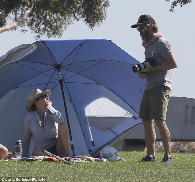 Made in the shade: The My Best Friend's Wedding stunner chatted with her hubby Danny Moder, 47, as he snapped shots of the sporty fun