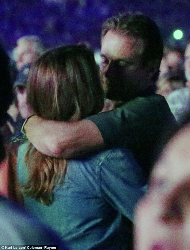 So romantic: Rande Gerber looked lovingly into wife Cindy Crawford's eyes during Paul McCartney's set at the Desert Trip Music Festival  in Indio, California, on Saturday evening