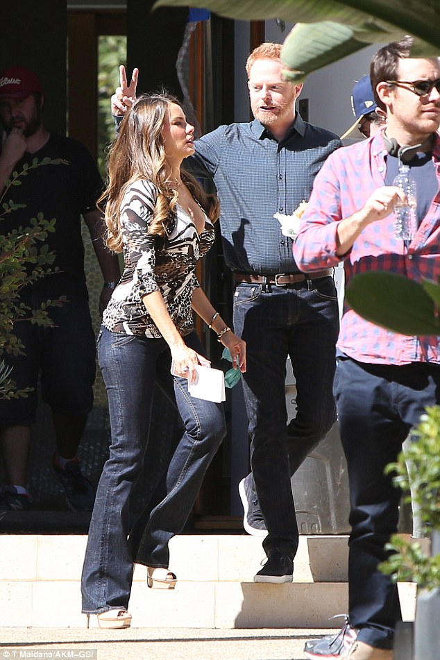 Bunny ears: Joining her on set was co-star Jesse Tyler Ferguson who was having a bit of a laugh at Sofia's expense