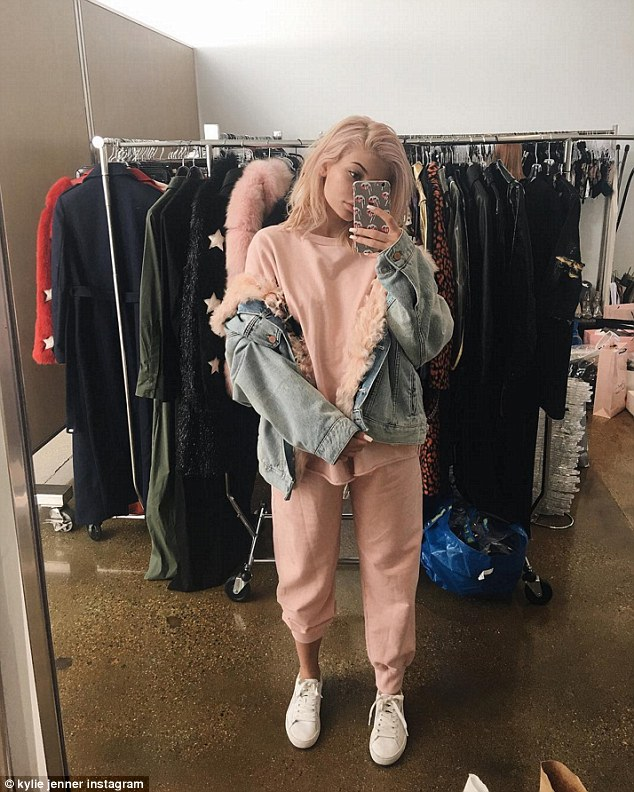 Pretty in pink! Kylie Jenner shared a mirror selfie of herself on Monday as she wore a baby pink sweatshirt and sweatpants along with a fur-lined jean jacket, an outfit that mixed bedroom chic with a bit of the 90s