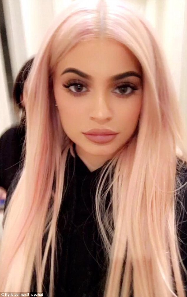 Picture perfect: Jenner also shared a photo of her flawlessly made up face and long pink locks