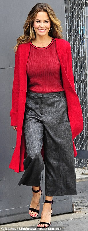 Fancy:The stunning beauty tucked the ribbed top with loose-fitting cropped trousers in a deep grey hue