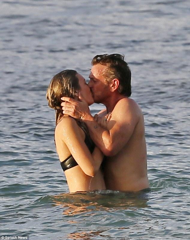 At it again Sean? Penn's 'secret girlfriend is heartbroken' after he is seen kissing Leila George, it has been revealed