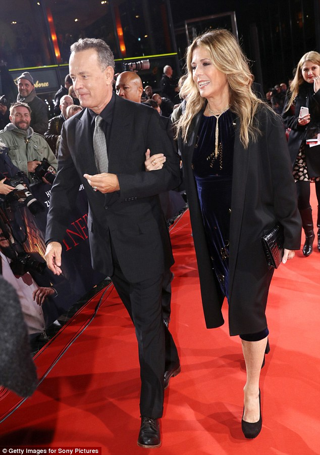 Arm-in-arm: The couple were inseparable as they navigated the red carpet