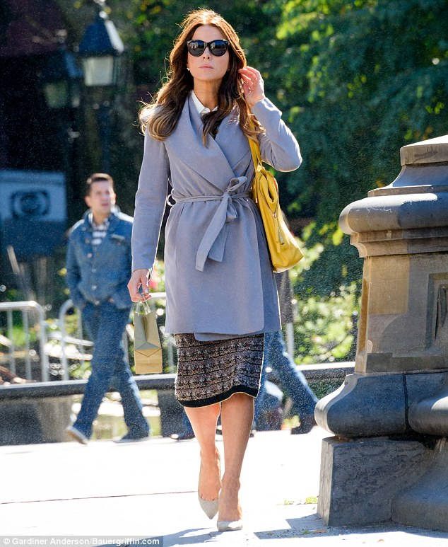 Belted up: The 43-year-old beauty kicked off the week looking stylish as she dressed for Fall on the set on the movie
