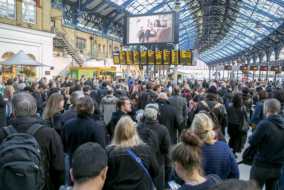 Waiting: Crowds on the concourse at Brighton station this morning during rush hour as strike action delayed trains