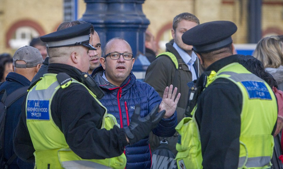Anger: Railway staff and union members face an angry backlash from passengers this morning as scenes of chaos unfolded