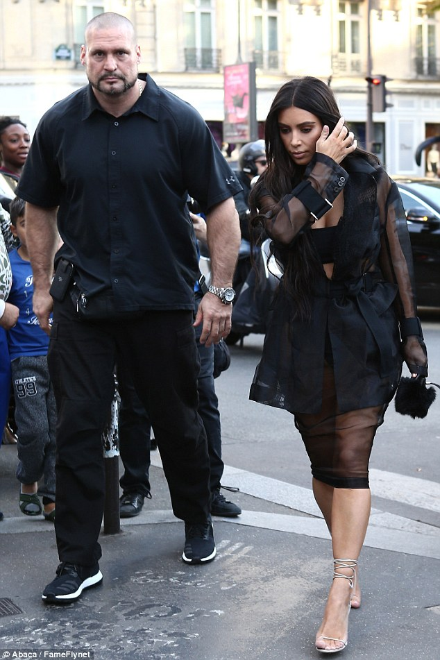 Beauty and the beast: Duvier, seen here last month with Kim at Paris Fashion Week, casts an imposing presence as the reality star's primary protector