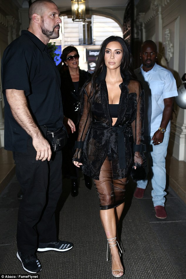 In with the in crowd: Sources told People that the Kardashian family is fond of the 6 ft., 4 in. defender. Here, Kim steps a pace ahead of her mother Kris Jenner and the Momager's love, Corey Gamble, during Parisian Fashion Week activities last month