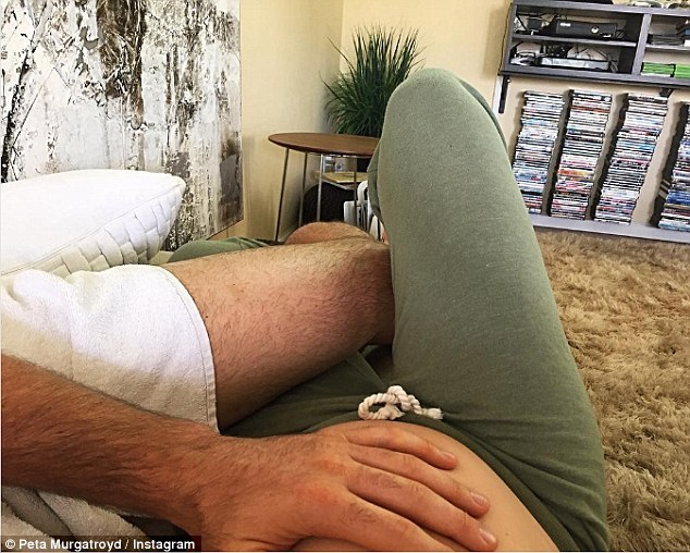 'Early morning snuggles': Peta took to Instagram on Saturday sharing an intimate moment with Maksim on their couch. His hand rested gently on her bare belly
