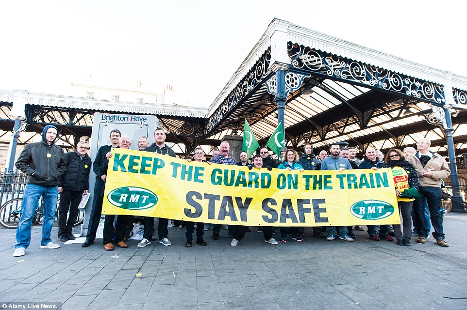RMT Union members protest outside Brighton Rail Station. Southern Rail guards start 72-hour walkout as part of a 14-day strike programme, over the ongoing dispute concerning the role of guards on Southerns services