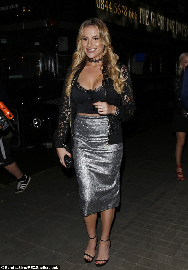 Interesting choice: TOWIE star Georgia Kousoulou opted for a bizarre ensemble comprising of a silver pencil skirt paired with a black crop top which struggled to contain her ample assets