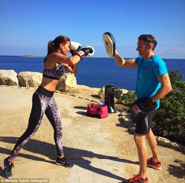It's Rocky Bal-whoah-a: Mel showed off her enviable physique while practising her boxing skills, just hours after touching down on the Balearic party island