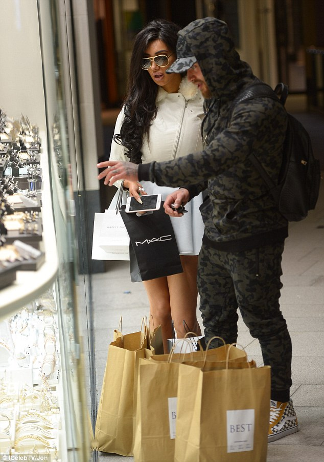 Thinking about the future: The glamour model and Ex On The Beach bad boy, 26, beamed in delight as they inspected a dazzling array of sparklers in a jewellery shop window