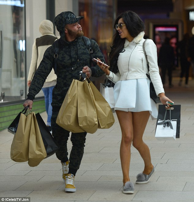 Funky: Taking time to ogle over the eye-catching pieces, his mustard-coloured trainers provided the best support as they walked away