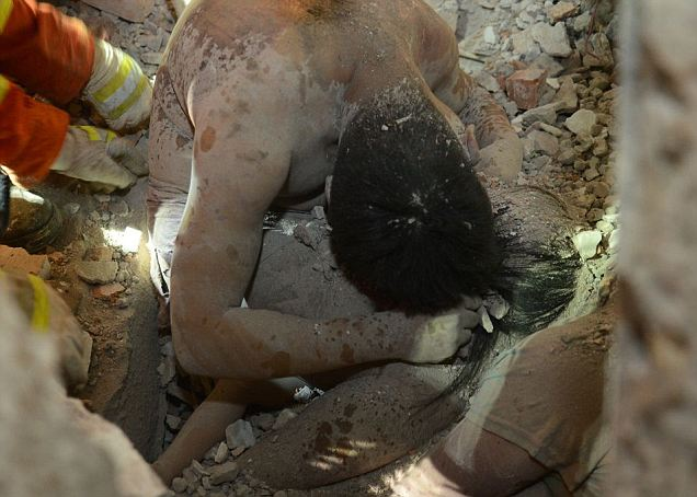 Chinese parents found dead shielding daughter in rubble of collapsed building