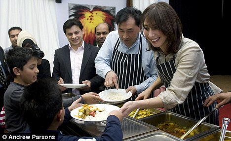 Samantha Cameron serves lunch as she visits the Surma Community Centre in North London