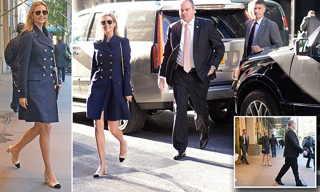 Ivanka Trump bundles up against the New York chill in a chic blue coat