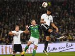 Germany¿s Sami Khedira, right, heads for the ball in front of Northern Ireland¿s Lee Hodson, center, and Germany¿s Mario Goetze, left, during the World Cup G...