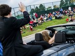 In this Friday, Oct. 7, 2016 photo, Kourt Frame, a transgender sophomore who was named Homecoming prince of his sophomore class waves outside of Grand Blanc ...