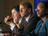 FILE - In this Thursday, March 26, 2015, file photo, Consumer Financial Protection Bureau Director Richard Cordray, center, listens to comments during a pane...