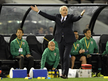 Japan manager Vahid Halilhodzic gestures during his team's World Cup qualifying match against Australia in Melbourne, Australia, Tuesday, Oct. 11, 2016. (AP ...