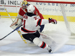 Florida Panthers goalie Roberto Luongo (1) deflects a shot by New Jersey Devils right wing Kyle Palmieri (21) during the first period of an NHL preseason hoc...