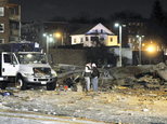 FILE - In this Nov. 23, 2012 file photo, gas company workers stand where a building once stood, which was leveled by an explosion in downtown Springfield, Ma...