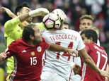 Poland's Lukasz Teodorczyk, center, is challenged by Armenia's Arsen Beglaryan, left, Hrayr Mkoyan and Vahagn Minasyan, right, during their World Cup Group E...