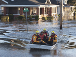 A swift water rescue team transports a resident of to safety on a street covered with floodwaters caused by rain from Hurricane Matthew in Lumberton, N.C., M...