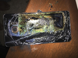 This Sunday, Oct. 9, 2016, photo shows a damaged Samsung Galaxy Note 7 on a table in Richmond, Va., after it caught fire earlier in the day. Samsung Electron...