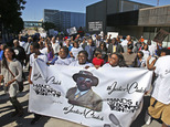 """FILE - In this Sept 27, 2106 file photo, people march in a """"National Prayer and Call For Justice"""" march in Tulsa, Okla., in response to the police shooting o..."""