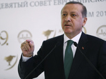 Turkish President Recep Tayyip Erdogan speaks during a meeting on Islam in Eurasia in Istanbul, Tuesday, Oct. 11, 2016. Erdogan says his country is determine...