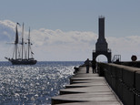 In this photo taken Oct. 3, 2016, the Denis Sullivan ship passes by the light head tower on the Port Washington, Wis. breakwater. About 120 lighthouses no lo...
