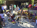 """People leave flowers at a memorial for Palm Springs Police Officers Lesley Zerebny, and Jose """"Gil"""" Gilbert Vega,seen in photos placed in front of the police ..."""