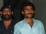 Waseem (right), brother of Qandeel Baloch, a social media celebrity, is escorted by police after arrest in Multan on July 16, 2016