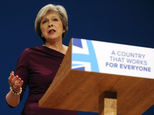 FILE - In this Wednesday, Oct. 5, 2016 file photo, Conservative Party Leader and Prime Minister Theresa May addresses delegates at the Conservative Party Con...