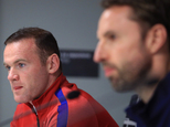 Wayne Rooney, pictured left, will be among the substitutes for Tuesday's game with Slovenia