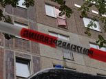 A pink curtain covers an opened window of an apartment in the Paunsdorf district of Leipzig, Germany, Monday, Oct. 10, 2016. Two days after explosives were f...