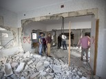 Palestinians inspect the house of Amjad Aliwi after it was demolished by the Israeli army in the West Bank city of Nablus, Tuesday, Oct. 11, 2016. Aliwi was ...