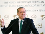 Turkish President Recep Tayyip Erdogan delivers a speech at the opening ceremony of 9th Eurasian Islamic Council in Istanbul on October 11, 2016