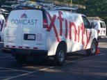 FILE - In this Sept. 17, 2015, file photo, Comcast trucks are parked in a lot in the company's Westford, Mass. operations center. Government regulators have ...