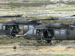 FILE -- In this June 18, 2015 file photo U.S. Army Black Hawk helicopters support soldiers during the NATO Noble Jump exercise on a training range near Swiet...