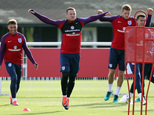 England's Wayne Rooney, center, attends a training session at Enfield Training Ground, London, Monday Oct. 10, 2016. England will play Slovenia in a World Cu...