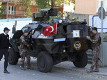 Members of special security force patrol  during a funeral ceremony for army officer Lt. Murat Taylan Oncel, 33, killed in a mortar attack Monday by Kurdish ...