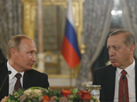 Turkey's President Recep Tayyip Erdogan, right and Russian President Vladimir Putin, left, look at each other during a news conference following their meetin...